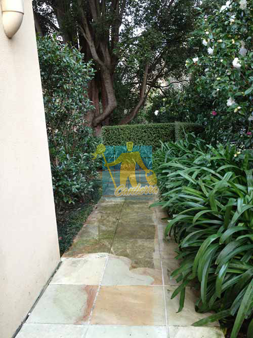 outdoor sandstone  pavers part cleaned part dirty while cleaning in garden Woden Valley