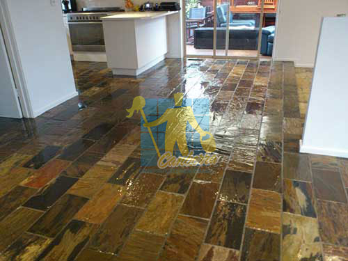 shiny floor with slate tiles after sealing still looking wet dark regular shape and size