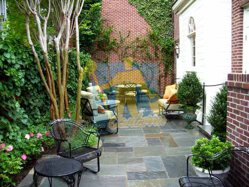 Canberra bluestone tiles outdoor backyard with furniture